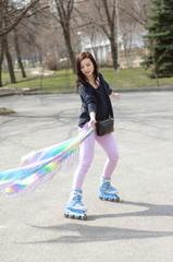 Girl in roller skate in the street.