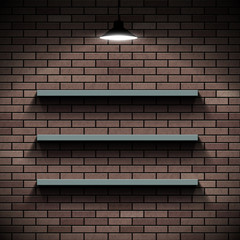 Empty shelves on a background of a brick wall. Illuminated by la