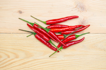 red chili pepper on wood background, spicy healthy herbal ingredient of Thai food.