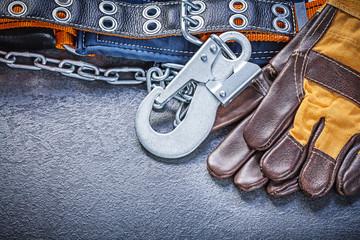 Construction safety belt gloves on black background maintenance