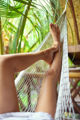 Sexy woman legs in hammock.Vacation concept