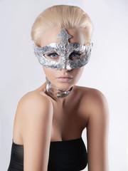 beauty woman in foil mask