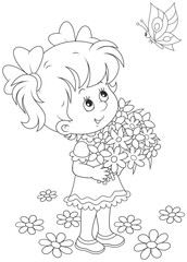 A cute little girl with a bouquet of flowers looking at a flying butterfly