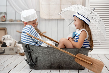 Children playing in the sailors in his room