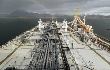 Discharging of moored to berth oil tanker.