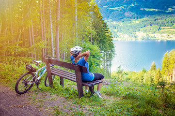 woman with bike resting above a lake-sportive holidays 08