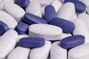 Blue and white pills close-up view