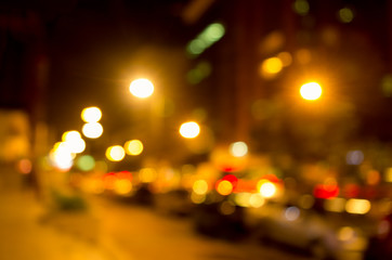Blurry yellow evening lights as seen through abstract artistic point of view in traffic