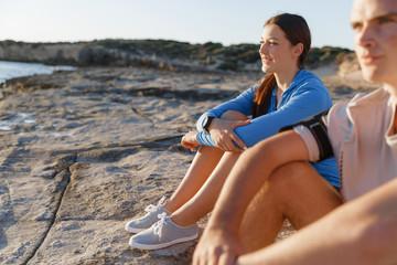 Couple in sport wear on beach