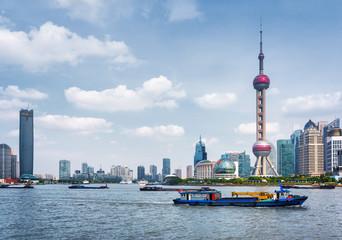 Boats crosses the Huangpu River in Shanghai, China