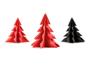 Origami Christmas tree paper isolated on white background. For decoration, Merry Christmas postcard vintage with red paper. Happy New Year. Front view. Close up.