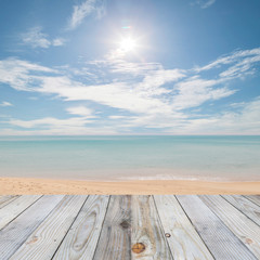 wooden floor with beautiful blue sky scenery for background.