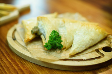 Puff pastry stuffed with parsley and mushroom