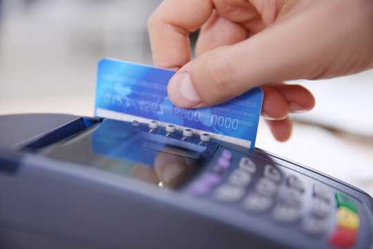 Businessman using payment terminal