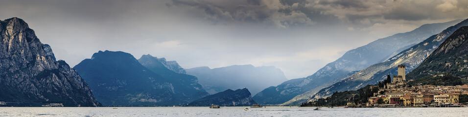 Malcesine, Panorama of Garda Lake at dramatic sunset, Lago di Garda Italy. Wall mural