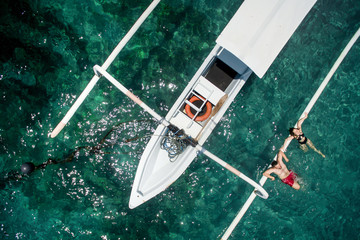 Romantic couple relaxing on a yacht in the sea while honeymoon