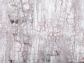 Old cracked paint on the wall. Grunge texture