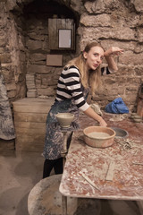 tired potter girl, woman in the pottery working.
