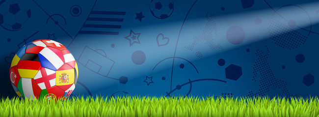 bunter EM Ball vor blauem Hintergrund auf Rasen