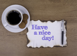 On the table a piece of paper and text. Have a nice day!