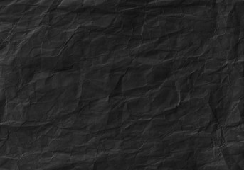 Black crumpled paper texture. Background and wallpaper