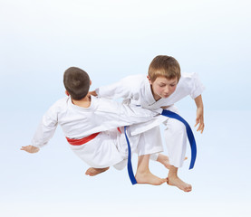 On a light background doing throws of judo athletes
