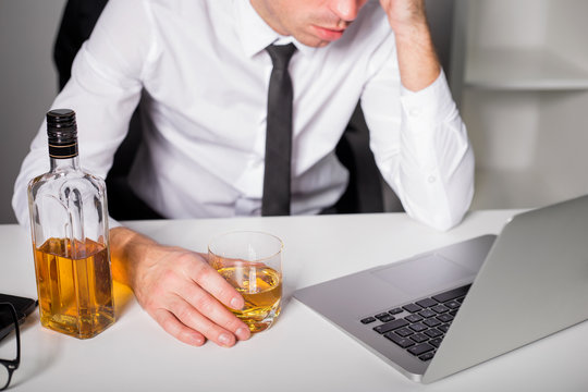 Man drinking at the office