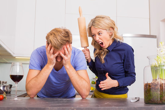 Woman in kitchen being angry at her man