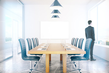 Conference room with businessman