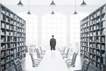 Library with table and person