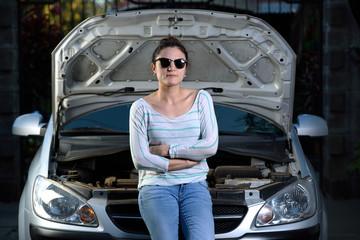 Girl sitting engine car door open