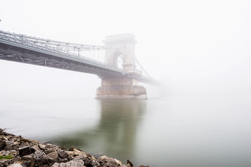 Chain Bridge over the Danube and a boat in Budapest, Hungary
