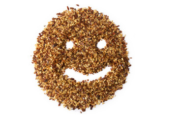 A pile of crushed red pepper flakes with a smiley face drawn in it.