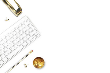 Flat lay, office white desk and keyboard with gold stationery. Gold stapler, stripe gold pattern, pencil. Floral tulip. View top. Table up. Mock-up background