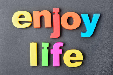 Enjoy life words on background