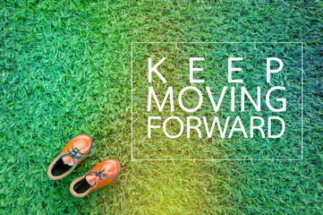 MOVING FORWARD concept with show on grass field.jpg