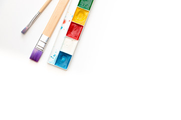 Watercolor paint and brushes isolated on white background