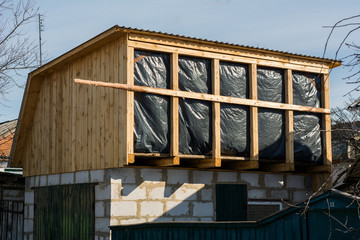 Building second floor extension on garage with water protective barrier