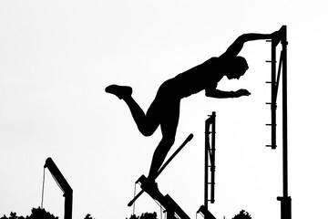 Pole vault athlete silhouette