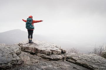 hiker at mountain top Wall mural