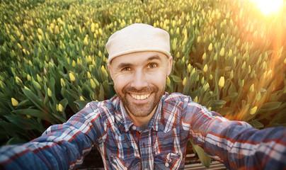 selfie man happy spring tulips field bouquet