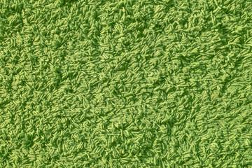 Closeup green yarn carpet