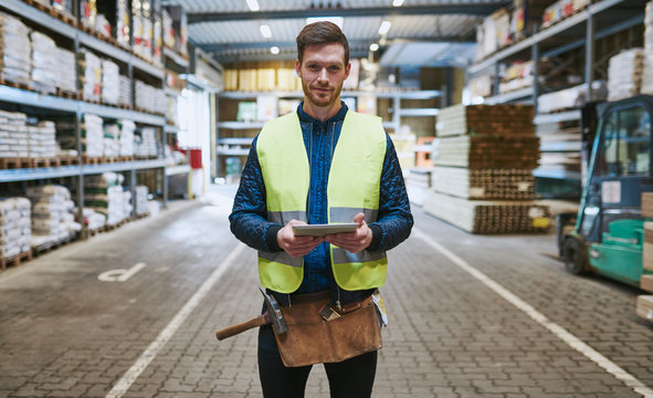 Young handyman or builder in a warehouse