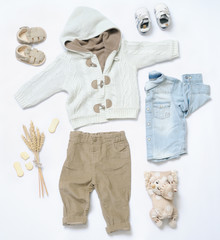 top view trendy look of baby boy clothes with toy in countryside