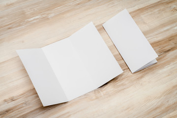 Trifold white template paper on wood texture..