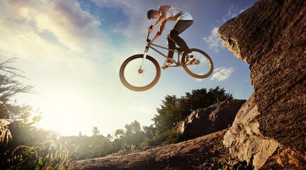 Sport. Biker jumps