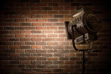 vintage theatre/movie spot light focused on a brick wall background
