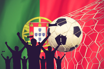silhouettes of Soccer fans with flag of Portugal .Cheer Concept