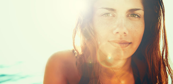 Face of young woman in summer sun