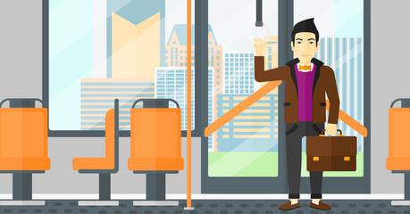 Man standing inside public transport.